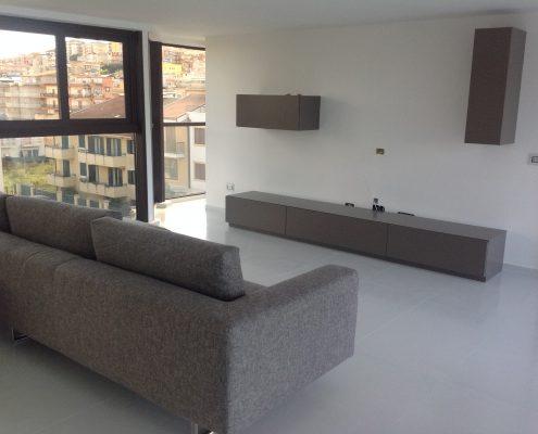 attico open space - parete attrezzata modulare Nestos - zona living